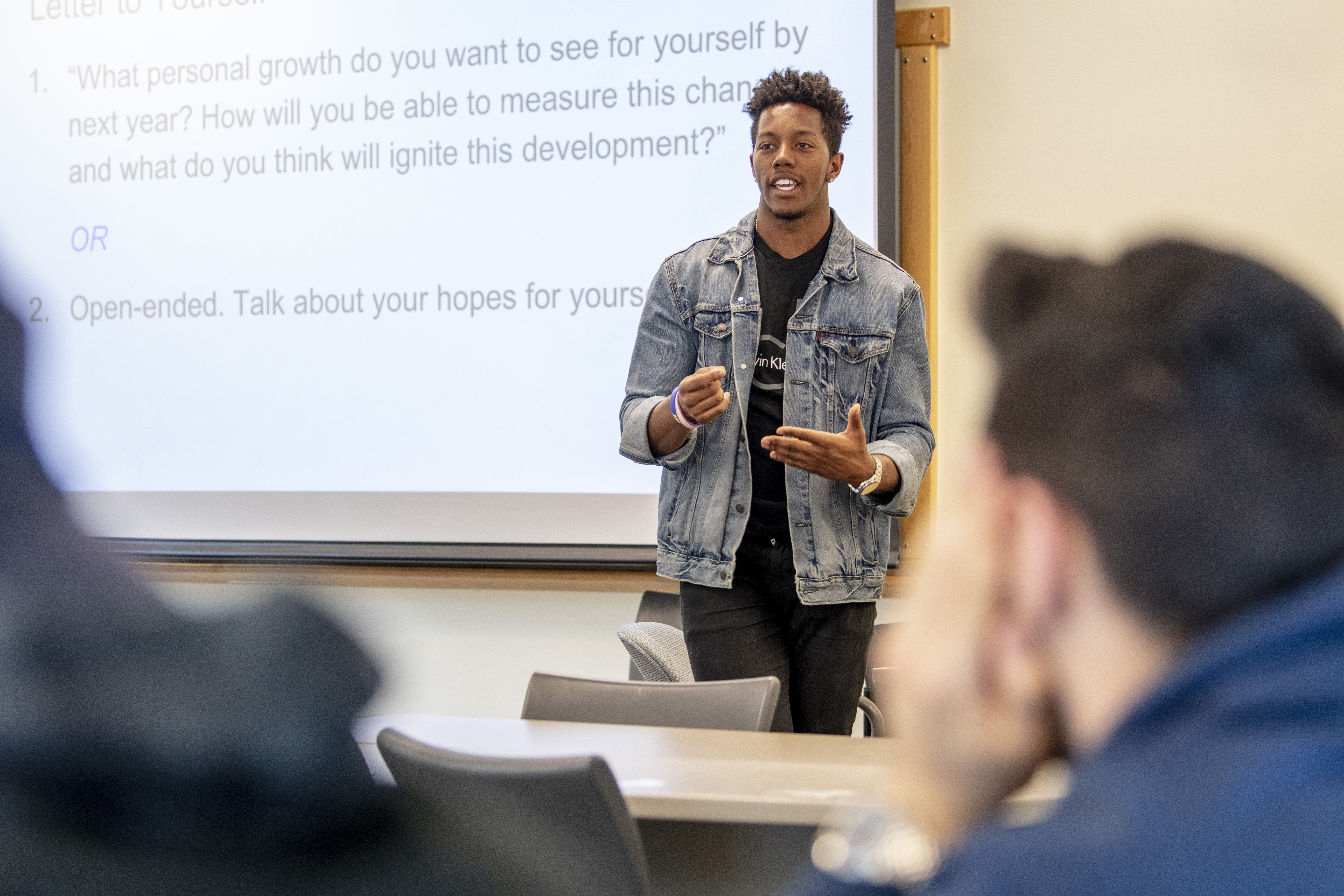 Student Shane Young teaching a First-Year Experience class at UConn.