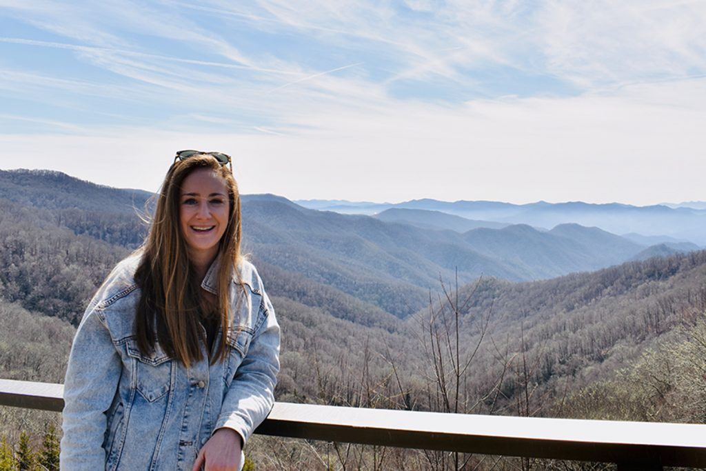 Michelle Wax '12 (BUS) poses for a photo in front of the Great Smoky Mountains in Tennessee. (Contributed Photo)