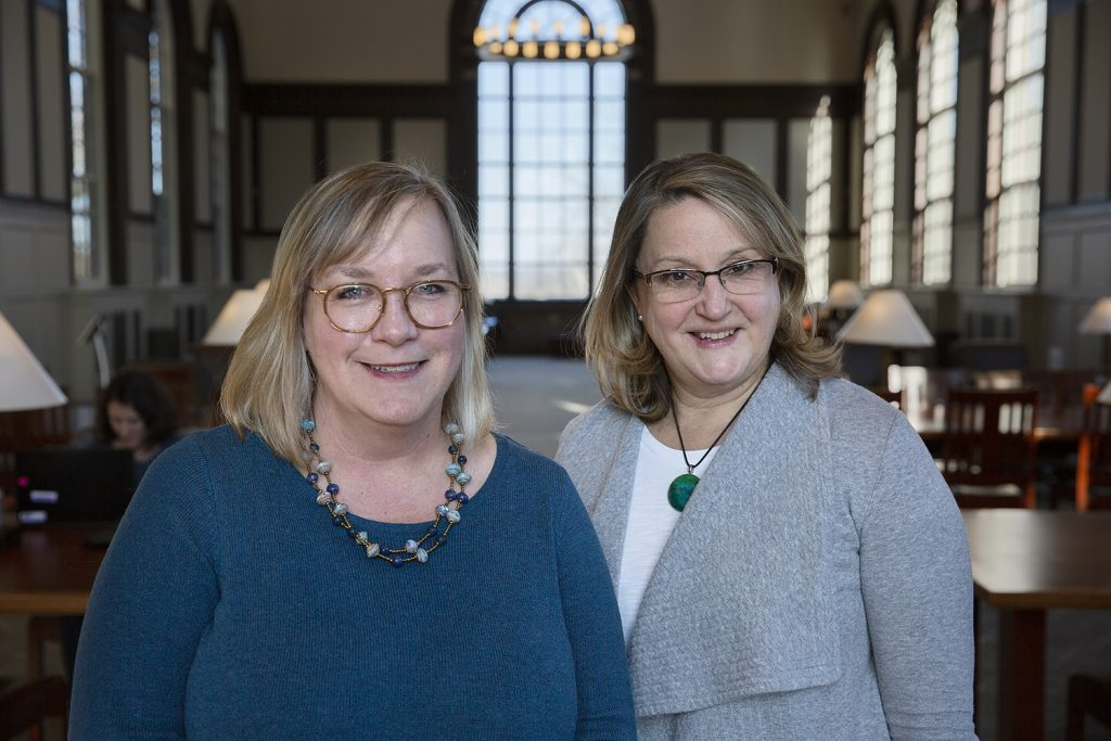 Katharine Capshaw and Lisa Park Boush stand together in the Wilbur Cross Building