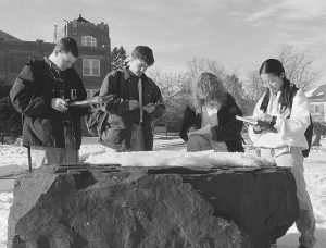 Students taking Geology 102 examine a rock at the old Geology Park, which was near Hawley Armory, in 1996. (Jonathan Cohen/UConn File Photo)