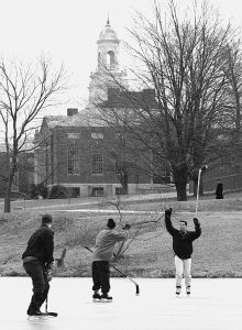 Students Chris Todisc, Jeff Benz and Eric Sanderson play hockey on Swan Lake in 1997. (David Ruddy/UConn File Photo)