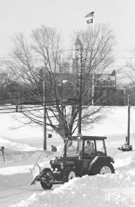 Dennis Kaba of UConn Facilities plows snow the morning after a blizzard in 1996. (UConn File Photo)