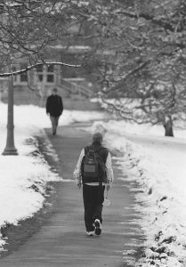 Students walking the paths of the (old) South Campus in the winter of 1995. (UConn File Photo)