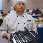 Chef Edgar Alzate showing tools of the trade during the Culinary Olympics on Jan. 14, 2020. (Sean Flynn/UConn Photo)