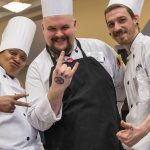 From left, chef Lucinda Simms, Gary Ellis, and Curtis Bangs having some fun at the 20th annual Culinary Olympics at UConn on Jan. 14, 2020. (Sean Flynn/UConn Photo)