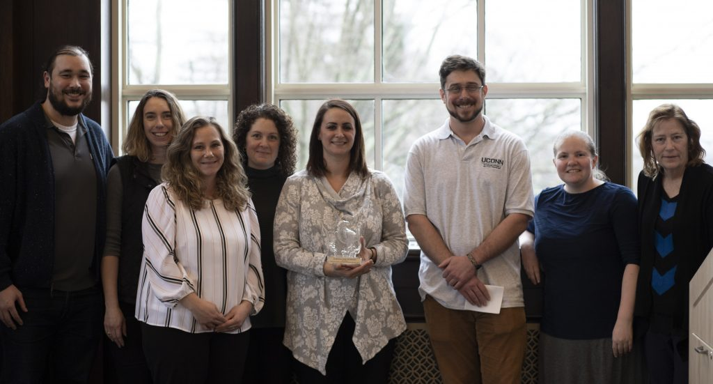 School of Nursing staff accept the trophy for the school's winning performance in UConn Office of Veterans Affairs and Military Programs' 7th Annual Homeless Veteran Care Package Drive on February 10, 2020, in the Wilbur Cross North Reading Room.