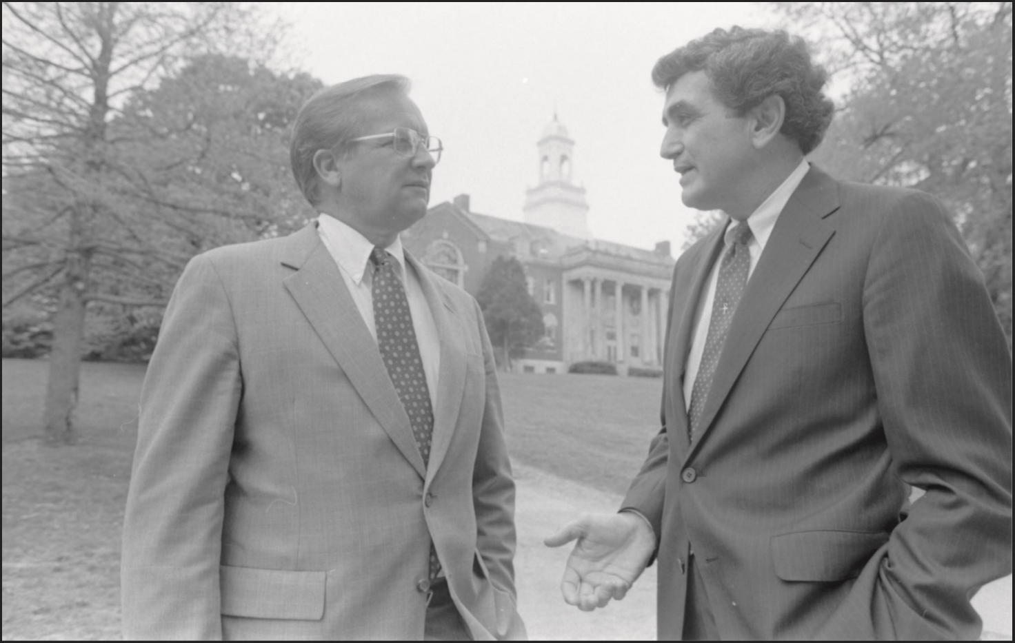 John DiBiaggio, right, UConn's 10th president, speaks with a visitor to campus in 1985. (Archives & Special Collections, UConn Library)