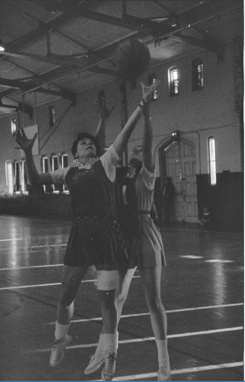 A 1969 of a moment in a women's basketball game between UConn and Springfield College.