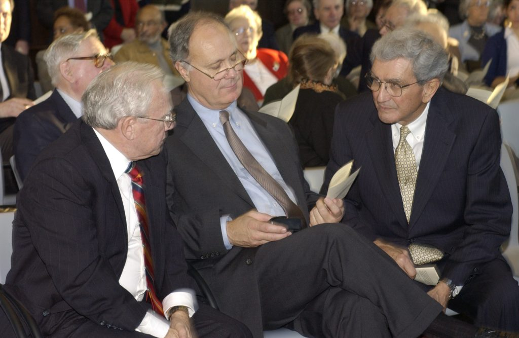 John DiBiaggio, right, speaks with fellow former UConn presidents Harry Hartley, left, and John Casteen at the rededication of the Wilbur Cross Building in 2002.