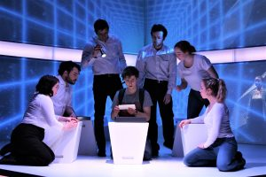"""Student actors perform onstage in the play, """"The Curious Incident of the Dog in the Night-Time."""""""