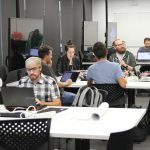 Participants working at the Evidence Synthesis Hackathon in Australia in 2019. (Courtesy of Neal Haddaway)