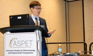 Liming Chen gives oral presentation at an ASPET meeting