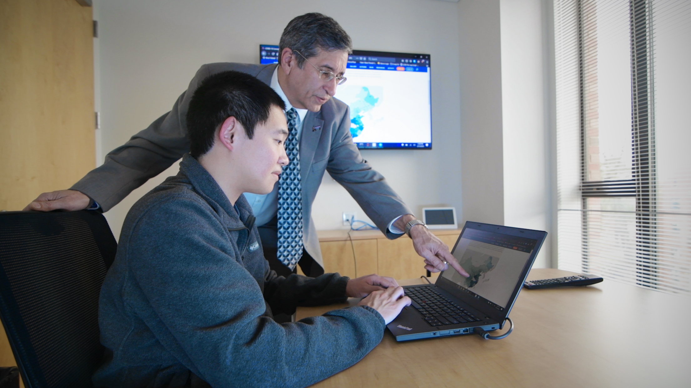Yuansun (Sonny) Jiang and Prof. Oskar Harmon examine the site Jiang built to track the spread of coronavirus in Connecticut. (UConn Photo)