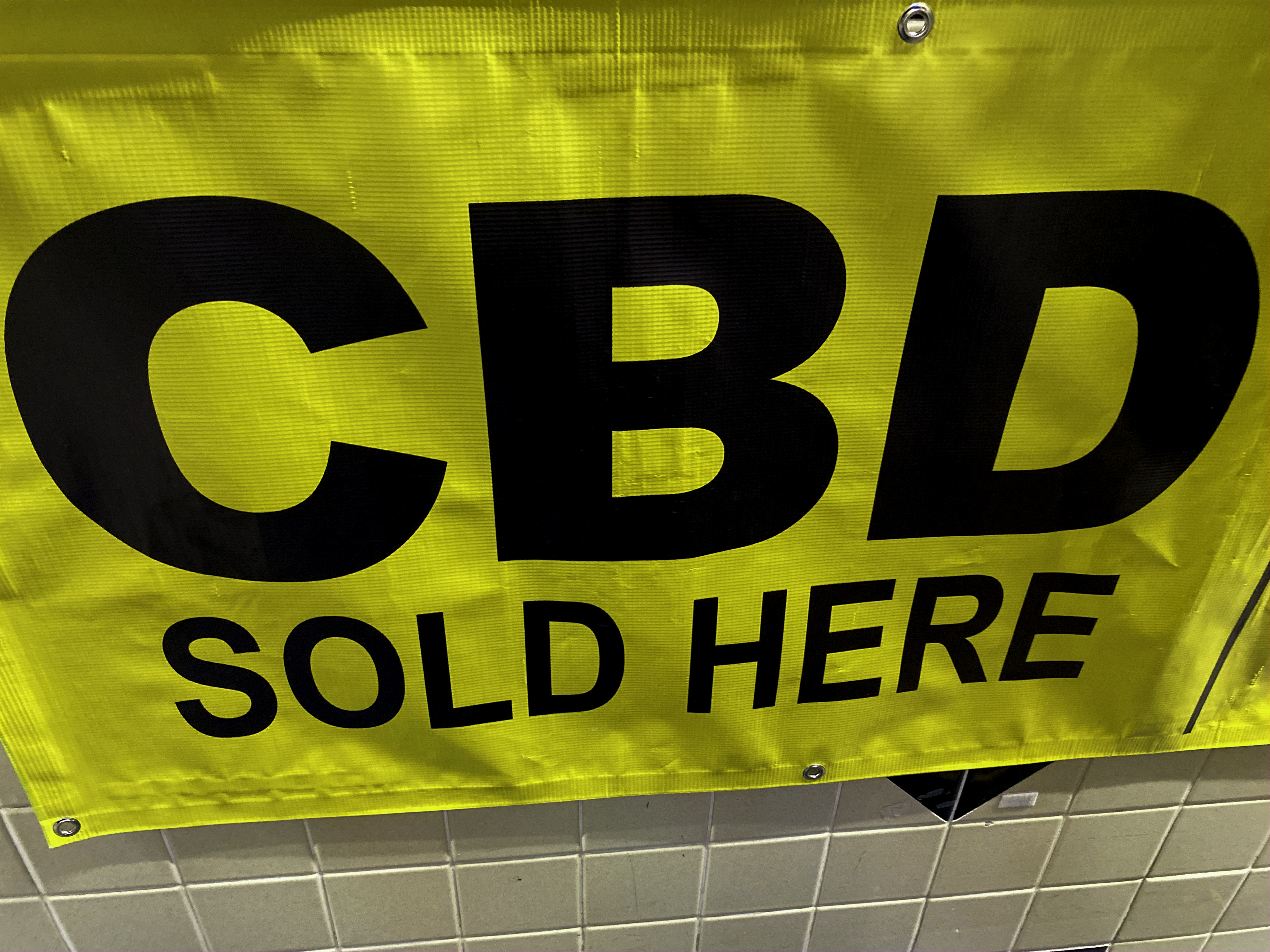 A sign advertising CBD oil for sale.