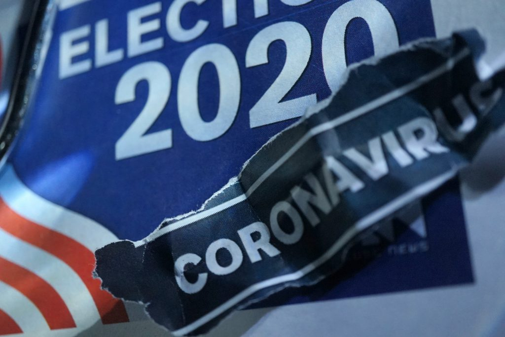 """An illustration showing a placard saying """"Election 2020"""" overlaid with a strip of paper saying """"coronavirus"""""""