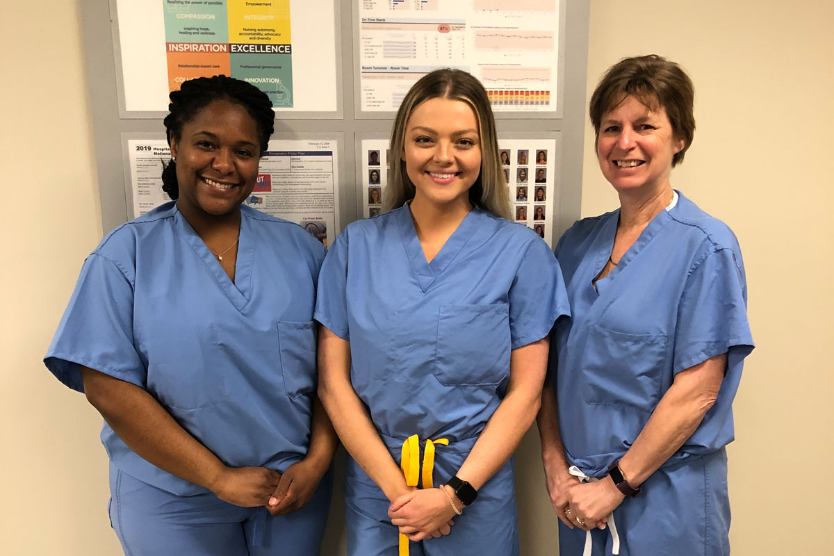 Portrait of recipients in scrubs outside the OR