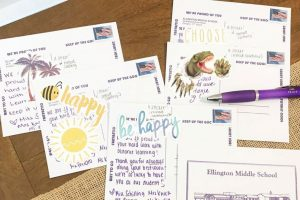 Alum Victoria Schilling writes postcards to her students.