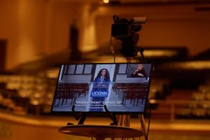 A television monitor shows Wanjiku Gatheru '20 (CAHNR) addressing the degree candidates during the virtual Commencement ceremony broadcast from the Jorgensen Center for the Performing Arts on May 9, 2020. (Peter Morenus/UConn Photo)