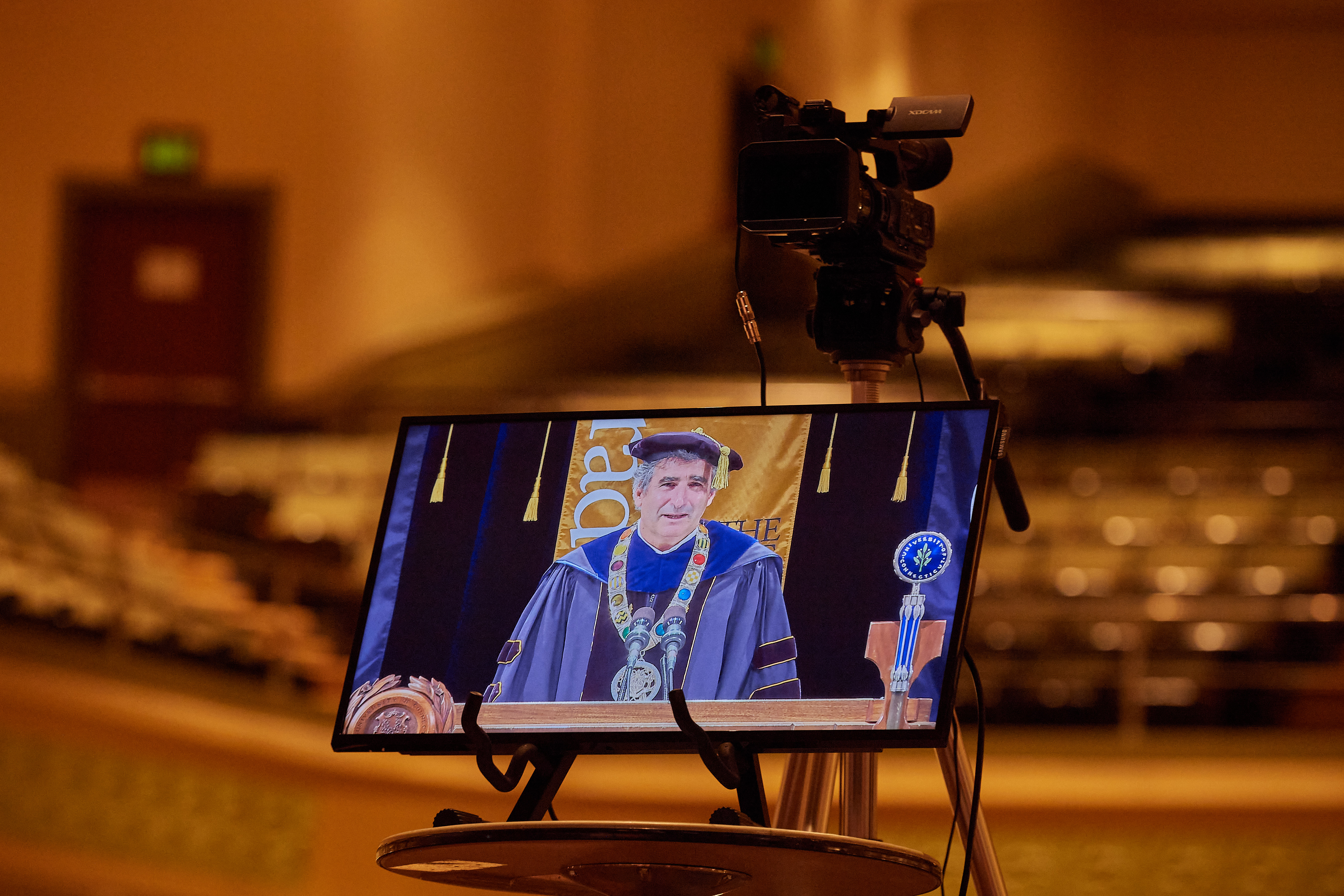 A television monitor shows President Thomas Katsouleas during the virtual Commencement ceremony broadcast from the Jorgensen Center for the Performing Arts on May 9, 2020.