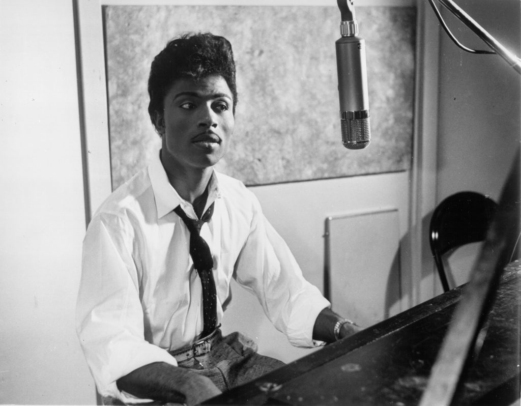Musician Little Richard performs on the recording studio at a microphone and piano in circa 1959.