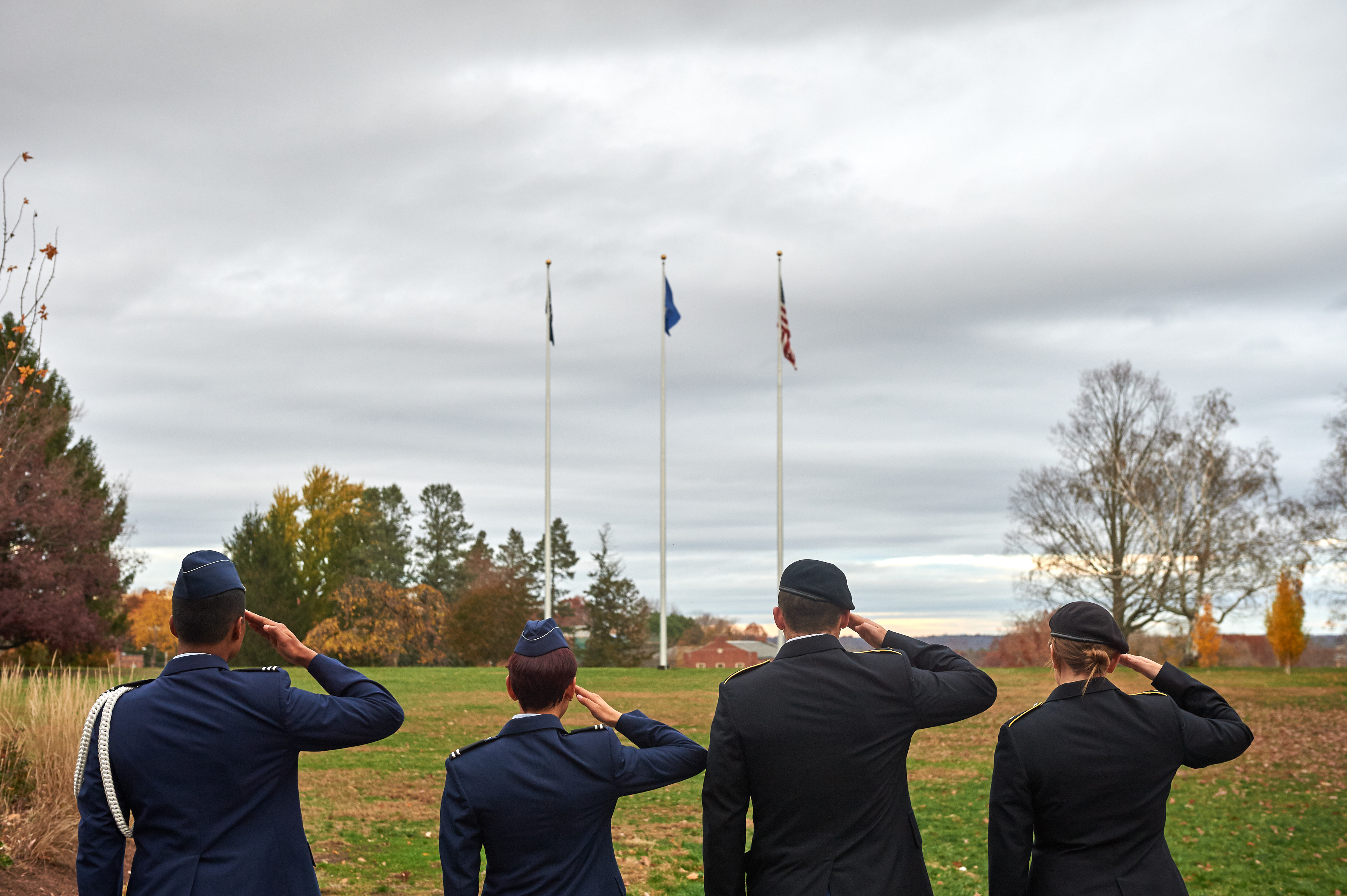 Army and Air Force ROTC members salute the flag on the Great Lawn