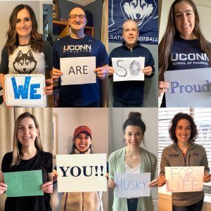 8 UConn Pharmacy faculty hold up sign in video to students