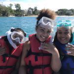 Seventh grade students enjoy their first snorkeling trip from a boat, in the town of Sosua. (Photo: Tessa Getchis)