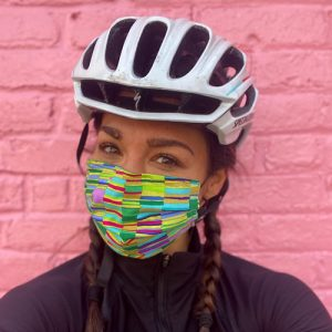 Woman in bike helmet wearing a mask.