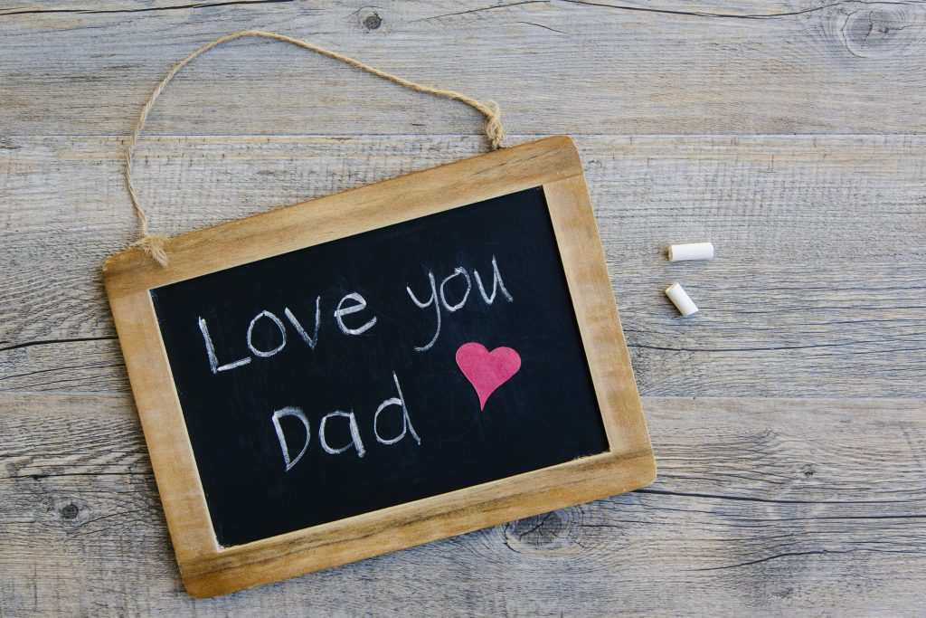 A message of 'love you Dad' on a blackboard written by a child for Father's Day.