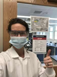 Julie Fosdick, assistant professor of Geosciences, pictured at her lab wearing a newly-required face mask (Photo by Julie Fosdick)