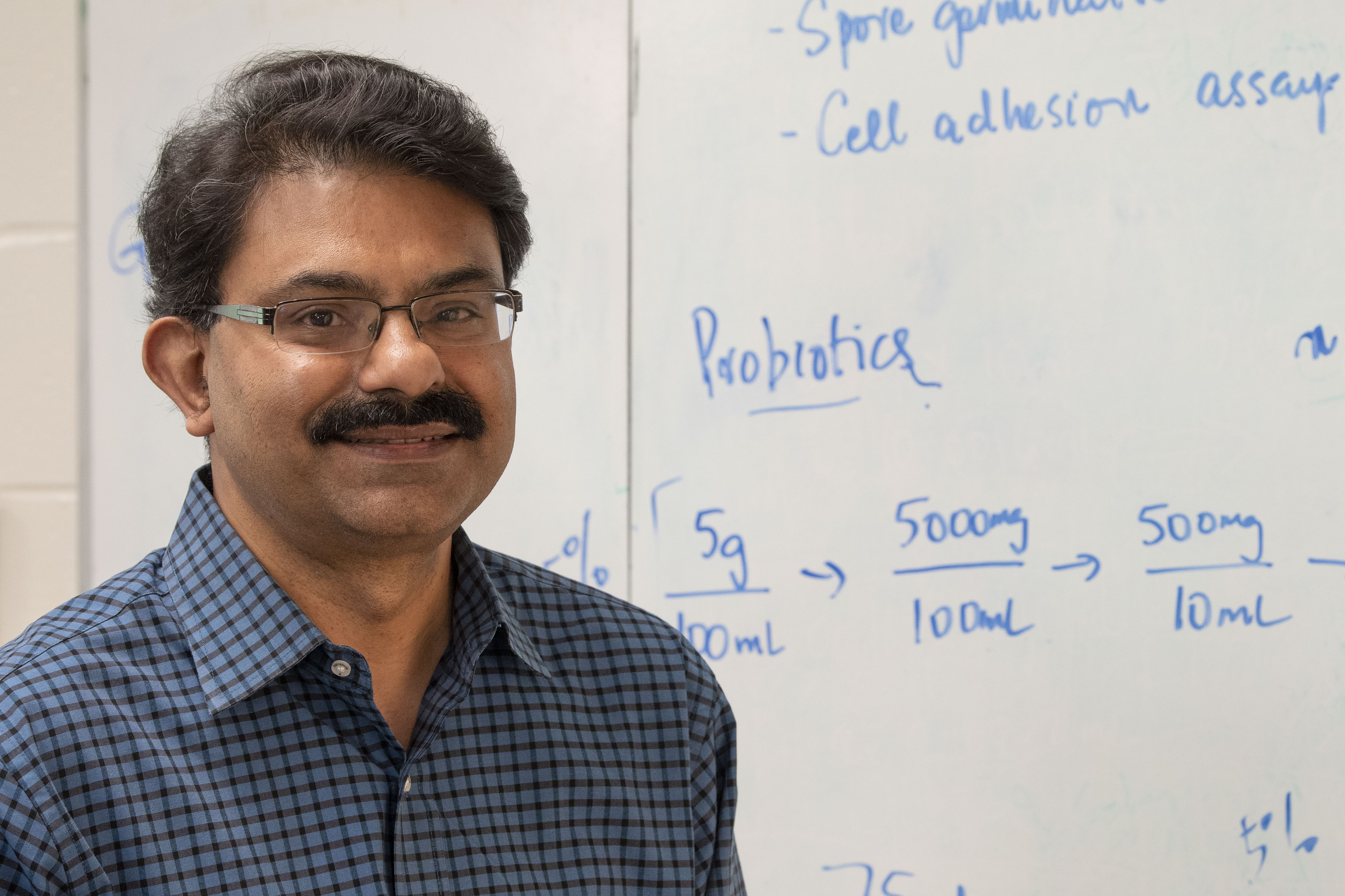 Researcher Kumar Venkitanarayanan at his lab in the George White Building.