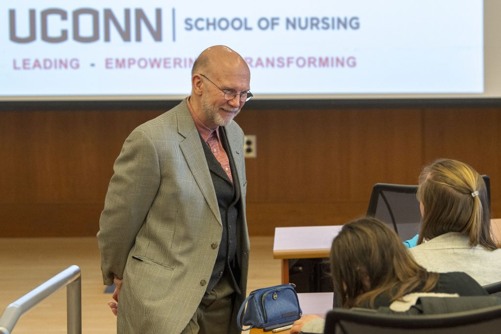 Professor Thomas Long gives a lecture in the Widmer Wing of the School of Nursing on Feb. 4, 2019.