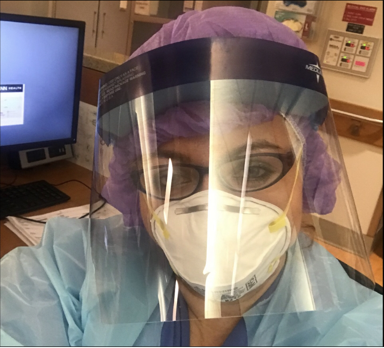 UConn Health nurse Maria Budzinski posing in a face shield and N95 mask.