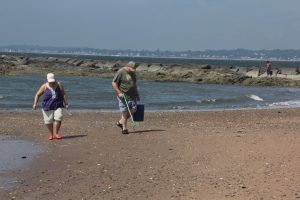 """Volunteers collect trash at Lighthouse Point Park in New Haven as part of the """"Break the Single-Use Plastic Habit"""" campaign by Connecticut Sea Grant and other groups last summer."""