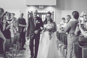 Lenny walking his daughter down the aisle