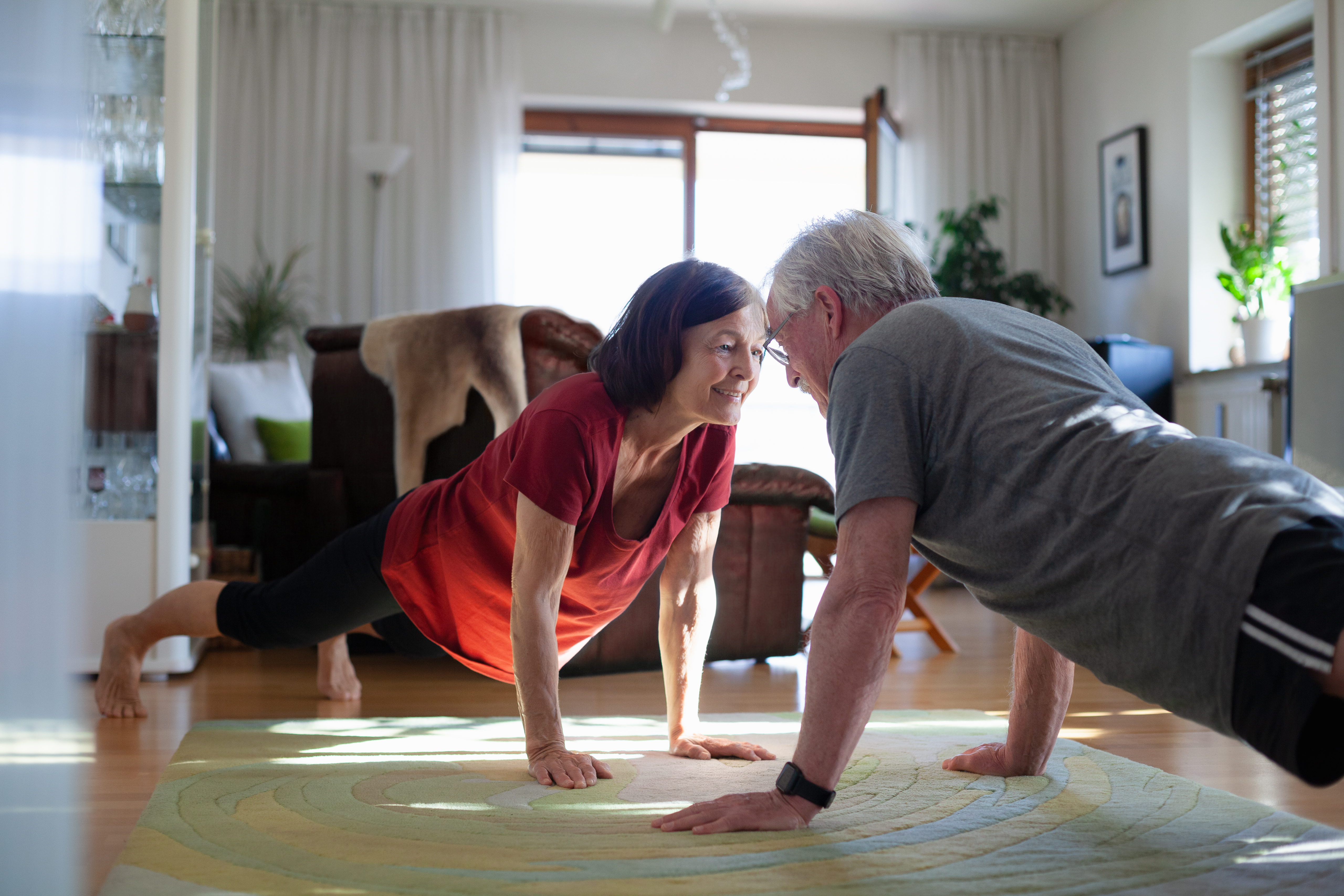 Senior couple staying home and staying fit during COVID-19 lockdown