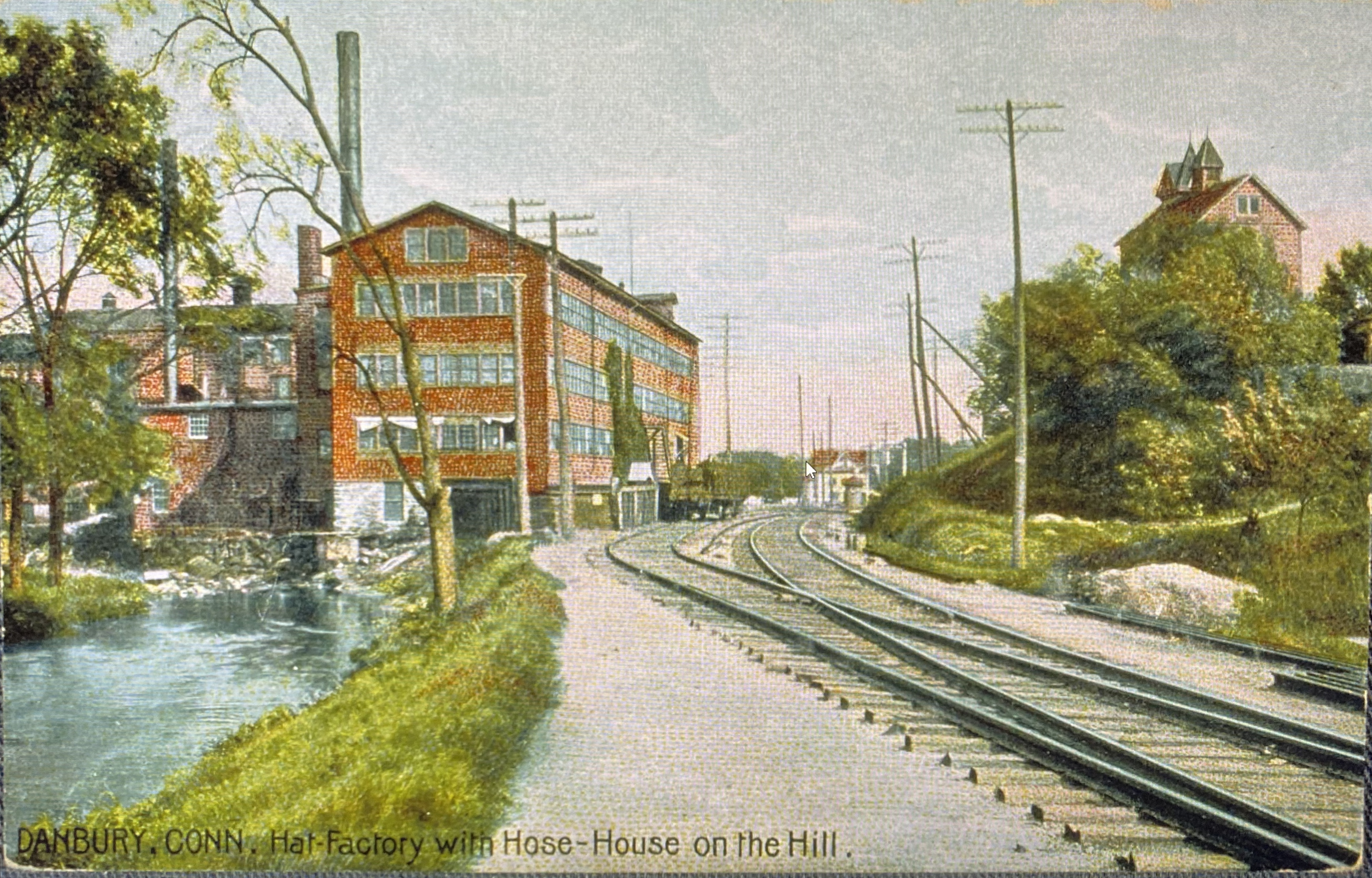 A colored postcard image of hat factory in Danbury