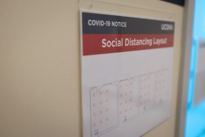Signs with social distancing guidelines will be familiar sights on all campuses (Sean Flynn/UConn Photo)