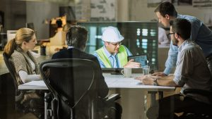 Architects and project manager in a video conference meeting with engineer.