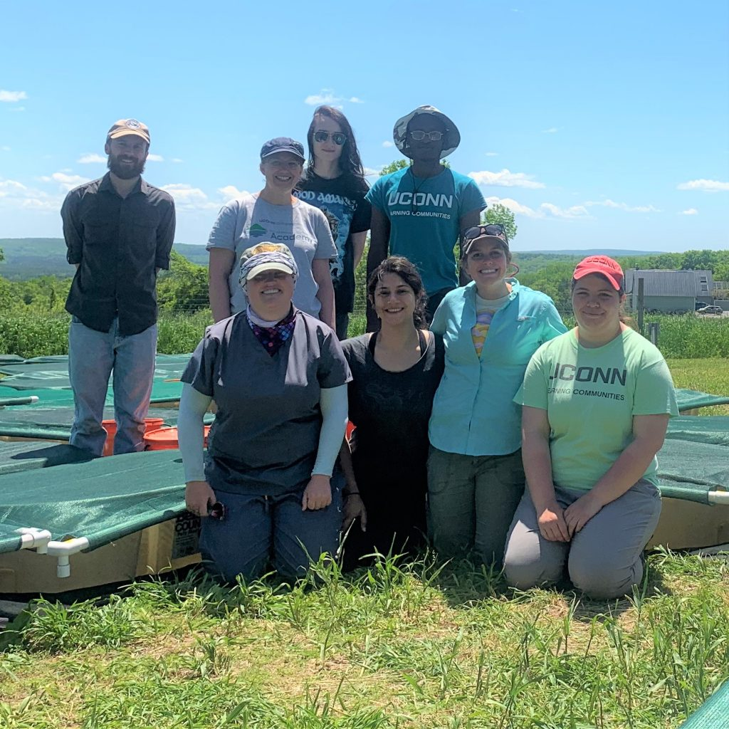 UConn Professor Tracy Rittenhouse (back row, second from left) and some students who worked with her on the tadpole research project.