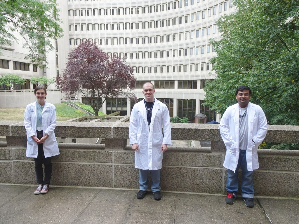 From left, research assistant Paige Woods, Biomedical Science PhD student Adam Tanguay, and Biomedical Engineering student Nikhil Menon, who assist Schmidt with his research.