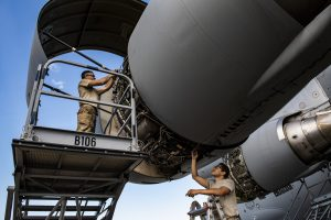 Technicians perform maintenance on a C-17 Globemaster III engine during a home station check inspection.