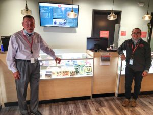 two men in front of a counter