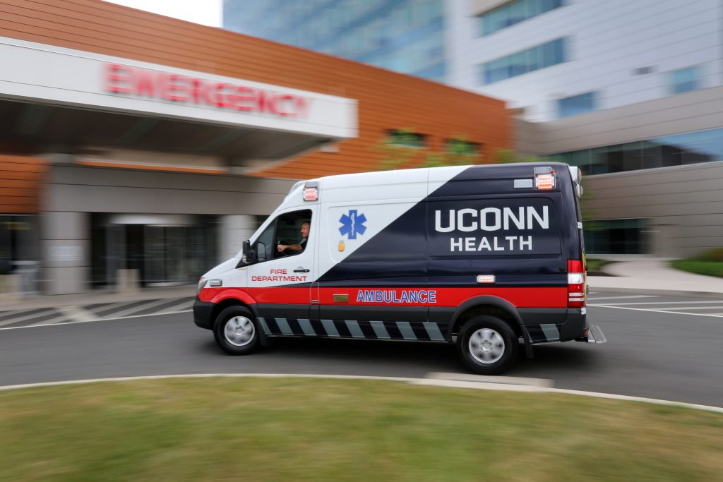 An ambulance pulls up to the emergency entrance at UConn Health