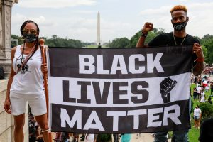 Protesters hold a sign in support of Black Lives Matter during the Commitment March on August 28, 2020 in Washington, DC.