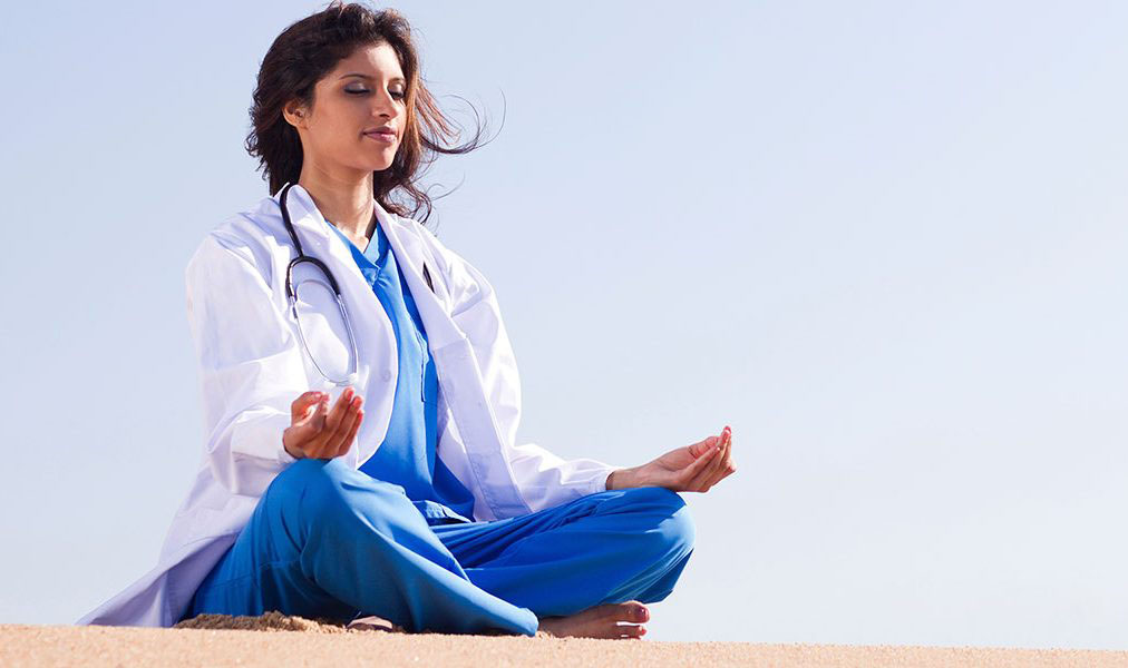 A portrait of a nurse meditating..