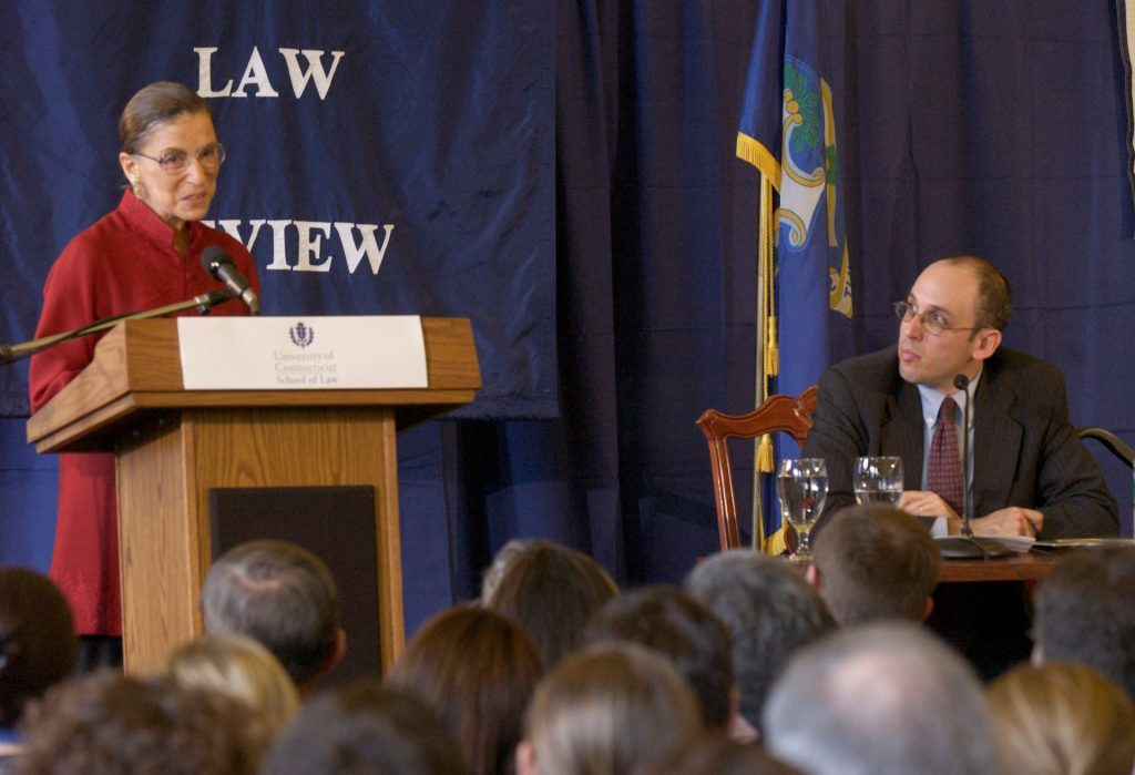 Justice Ruth Bader Ginsburg speaks in the Reading Room in William F. Starr Hall at the UConn School of Law in Hartford on March 12, 2004. At right is her former clerk, Paul Schiff Berman, who was then on the law school faculty and who moderated a question-and-answer session.
