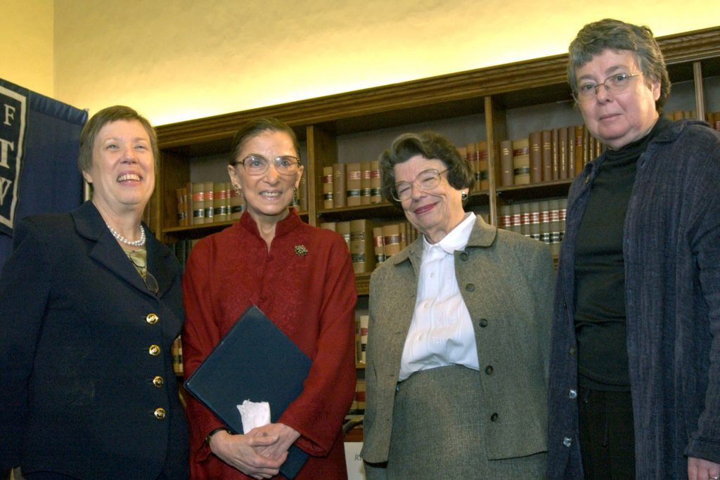Supreme Court Justice Ruth Bader Ginsburg spoke during her 2004 visit to the UConn School of Law about the challenges women faced in their law careers. From left: Nell Jessup Newton, then dean of the law school; Ginsburg; Ellen Ash Peters, the first female chief justice of the Connecticut Supreme Court; and UConn Law Professor Carol Weisbrod. (UConn School of Law Archives)
