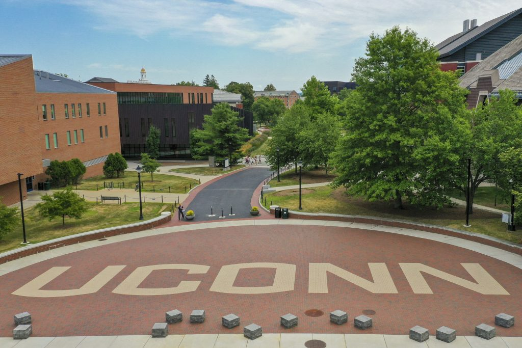 "An aerial view of Fairfield Way, showing the word ""UConn"" spelled out in brick work."