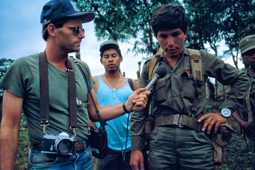Scott Wallace interviewing an officer from the Sandinista Popular Army